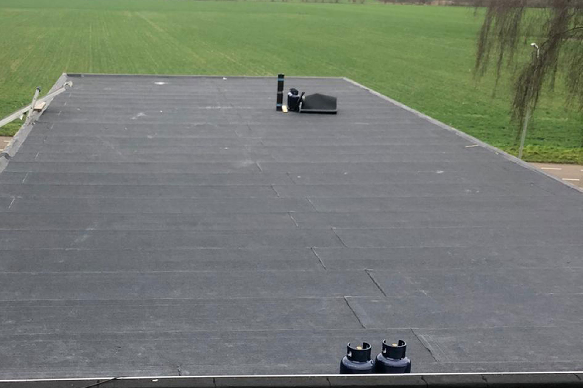 Bitumen dak loods Roermond